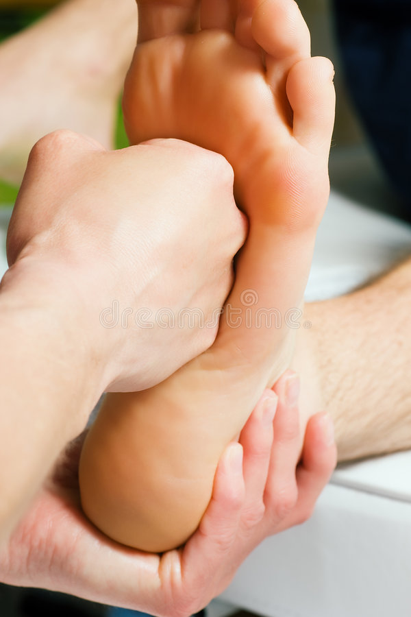 Foot massage with fist