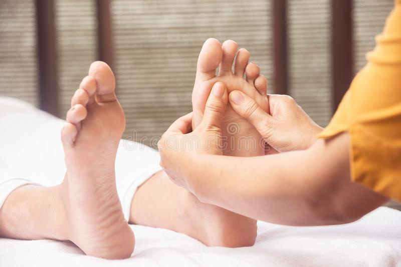 Foot massage in the spa centar royalty free stock photos