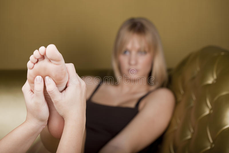 Foot massage in a SPA center stock photo