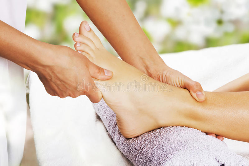 Foot massage in the spa salon royalty free stock photos