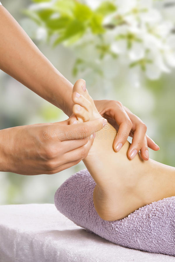 Foot massage in the spa salon stock photos