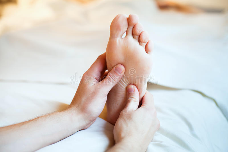 Foot massage stock photography