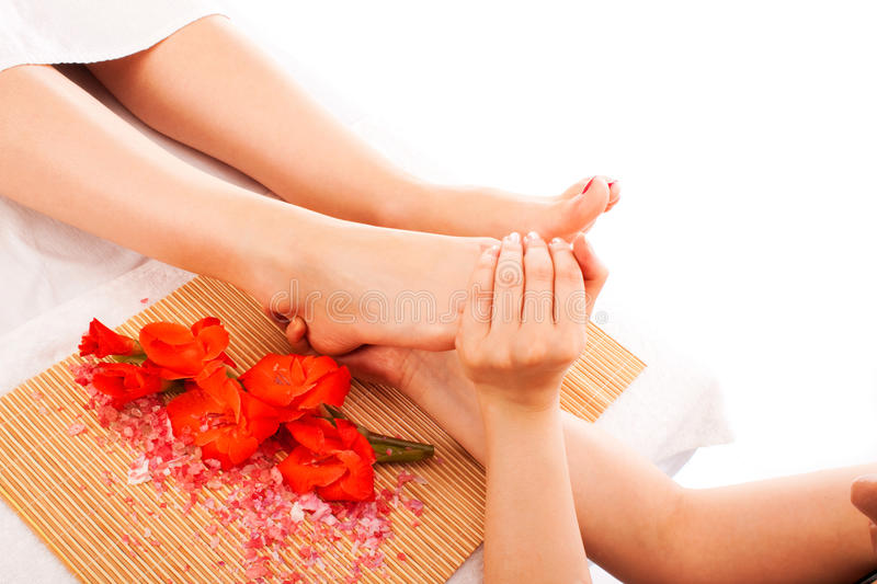 Foot massage at spa stock photos