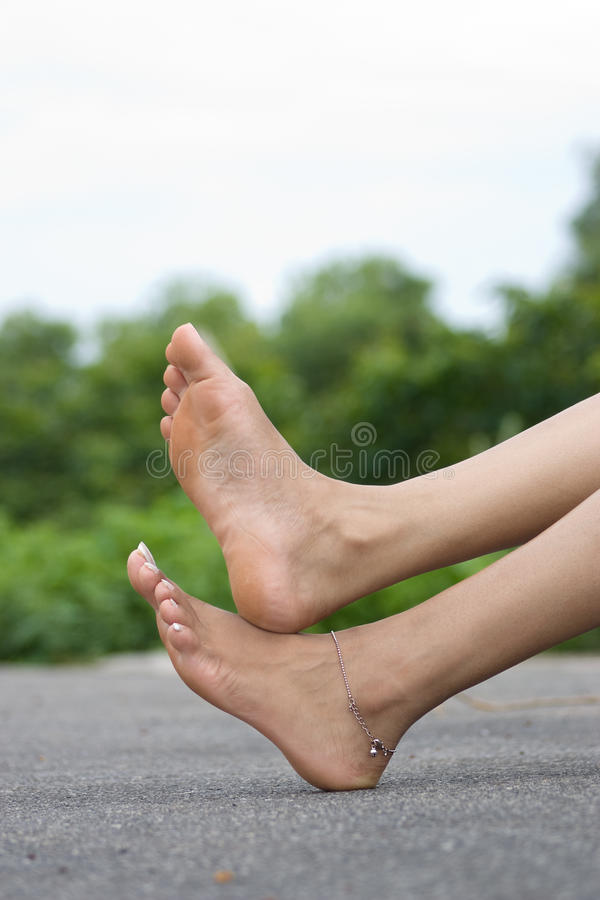 Foot over road stock photography