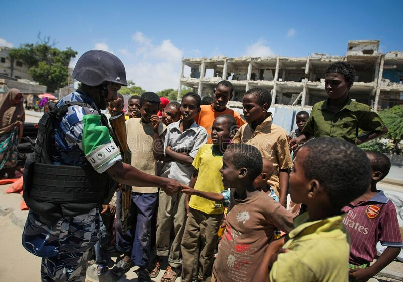 On foot patrol in Mogadishu with an AMISOM Formed Police Unit 14 royalty free stock image