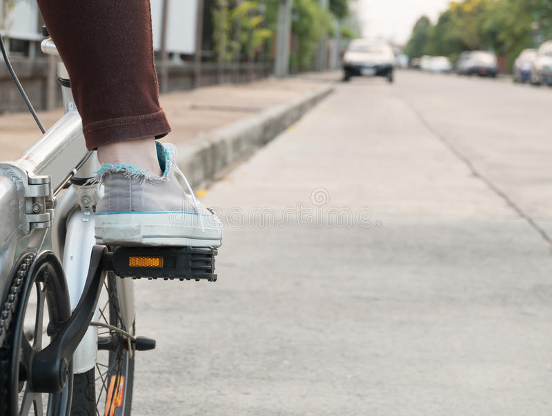 Foot on pedal of bicycle ready for departure. Cycling in Thailand royalty free stock photo