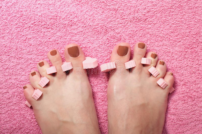 Foot pedicure applying royalty free stock photography