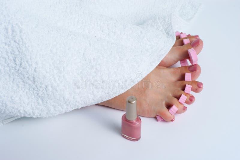 Foot pedicure applying royalty free stock photos