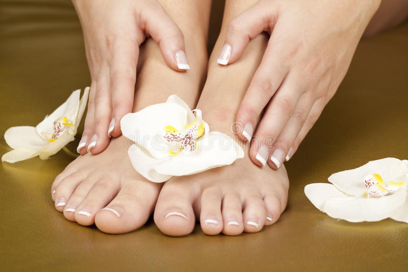 Foot after pedicure and french manicure nails stock photo