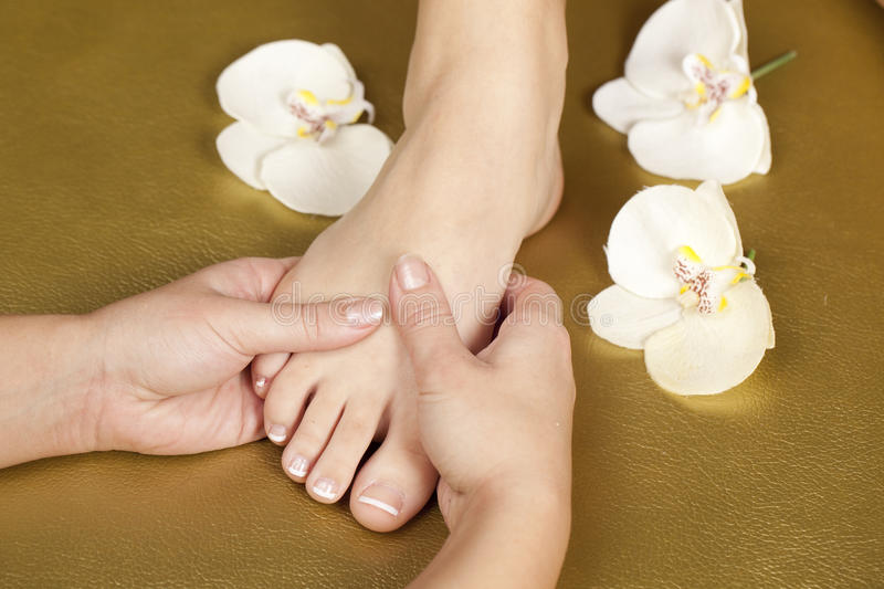 Foot pedicure and french manicure nails royalty free stock photography
