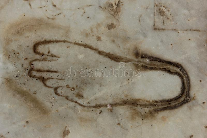 Foot Print. A foot print carved into the marble at the ancient city of Ephesus in Turkey royalty free stock photo