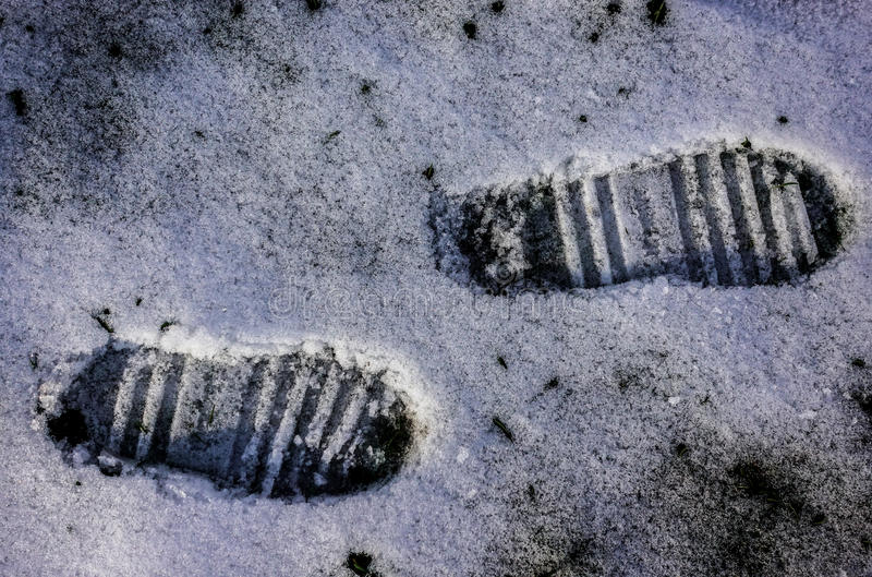 Foot print on snow royalty free stock photo