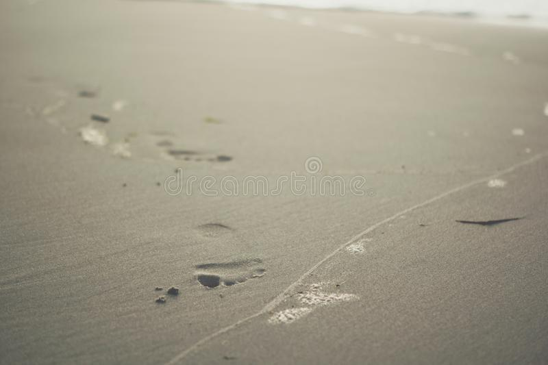 foot prints on a sand royalty free stock photo