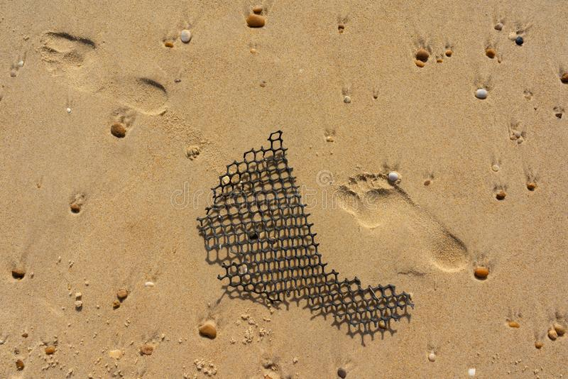 Foot prints in the sand royalty free stock photo