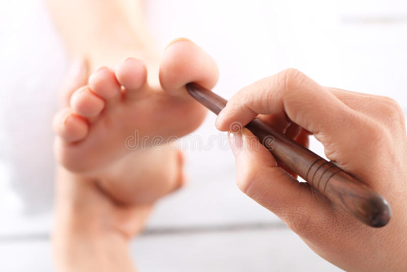Foot reflexology. Natural medicine, reflexology, acupressure foot massager oppresses energy flow points stock photos