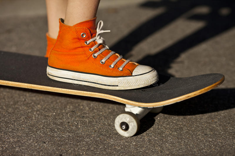 Foot and skateboard royalty free stock photography