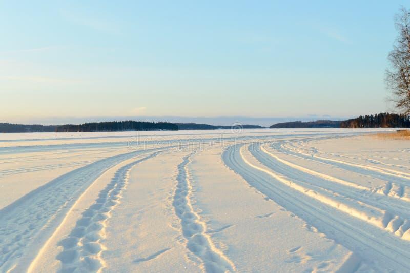 Foot steps on skandinavien winter frozen lake royalty free stock image