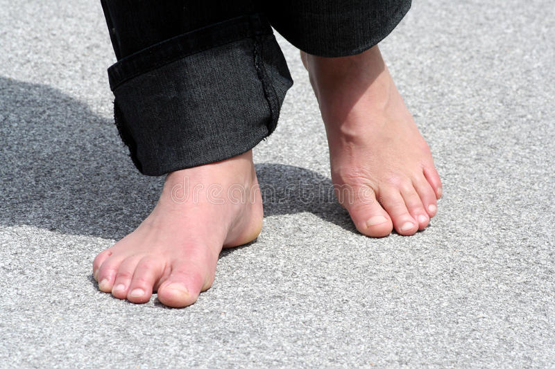 Foot walking. Barefoot walking in the summer time royalty free stock photo