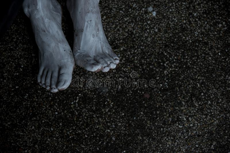 Foot of woman ghost creepy on the ground floor. With copy space for text royalty free stock images