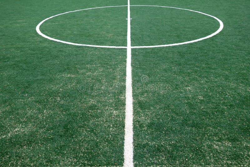footbal领域的片段与人为草的 免版税库存图片