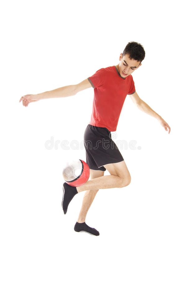 Football. Young man playing football isolated in studio on white background stock photos