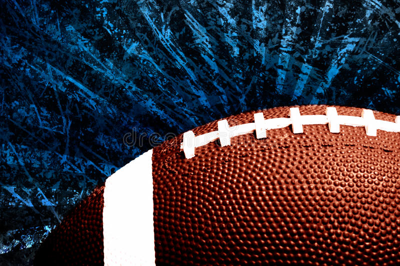 Football. Against scratched grungy blue sun burst illustraion background