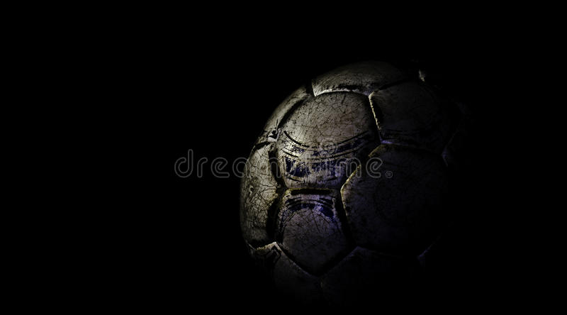 Football. In front of black background, with strong, dark shadows stock photo