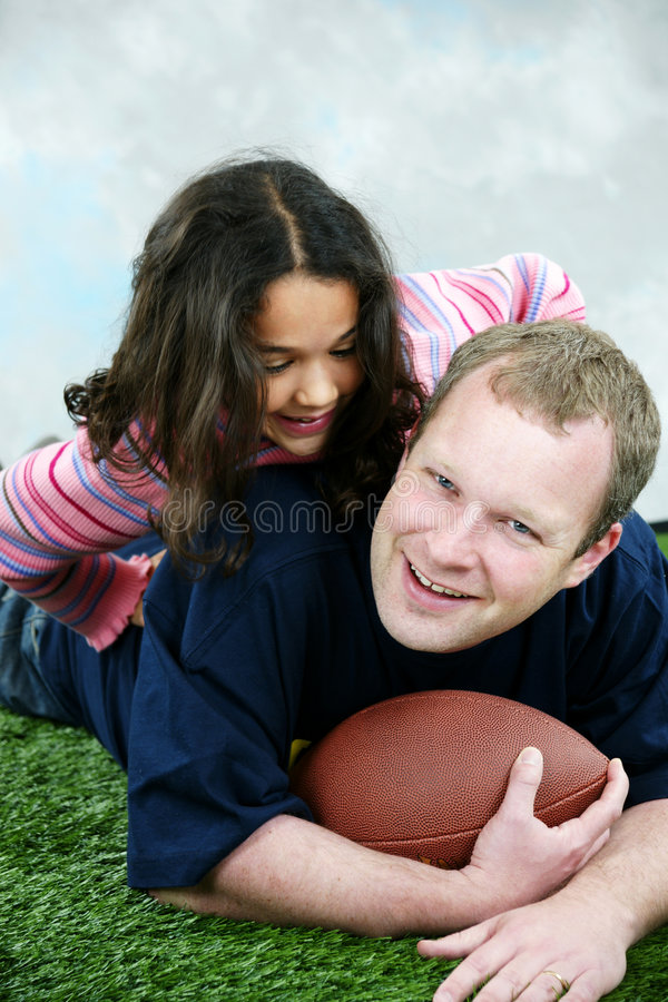 Football. Father and daughter playing football royalty free stock photography