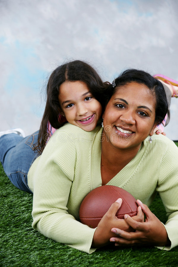 Football. On a field with child and mom royalty free stock image