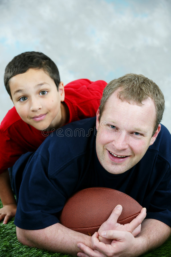 Football. Father and son playing football royalty free stock photos