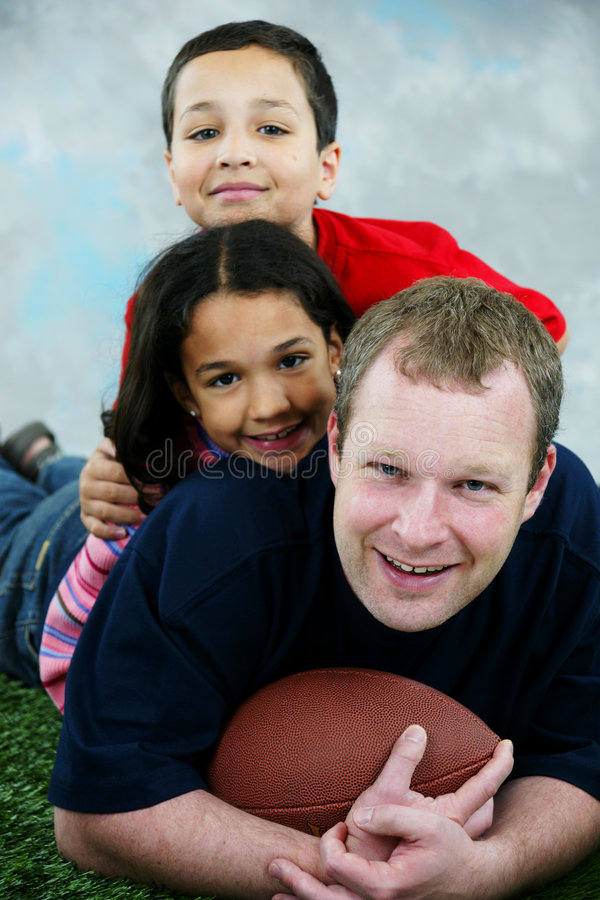 Football. Father and son and daughter playing football royalty free stock photography