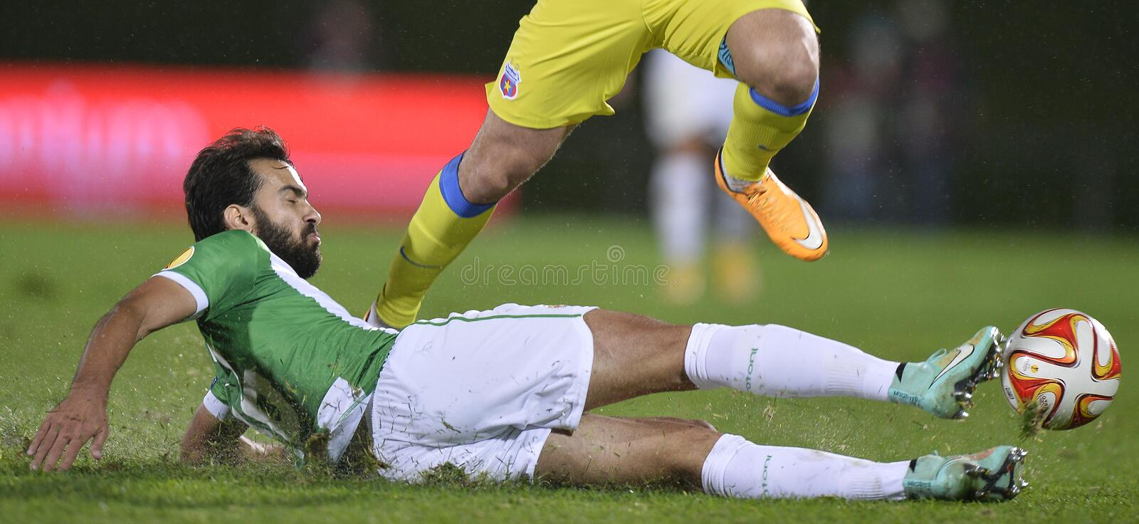 Football action - hard sliding tackle. Ricardo Jose Vaz Alves Monteiro, commonly known as Tarantini, player of Rio Ave Futebol Clube takles hard during the game royalty free stock images