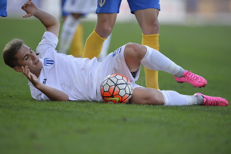Football action - sliding tackle. Bogdan Vatajelu player of CSU Craiova takles during the match between his team and Petrolul Ploiesti, Romanian League One stock image