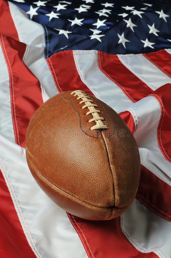 Football against an American flag. On a vertical format stock photography