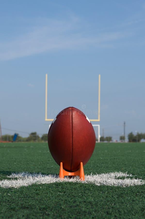 Football américain piqué vers le haut pour le début photo stock