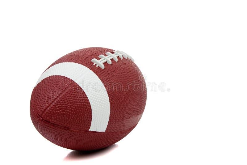 Football americano su una priorità bassa bianca immagini stock
