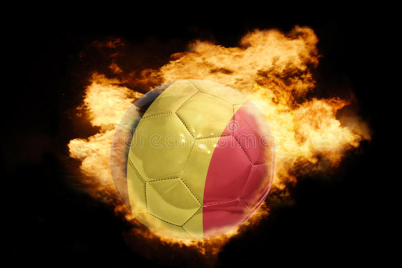 Football ball with the flag of belgium on fire stock photo