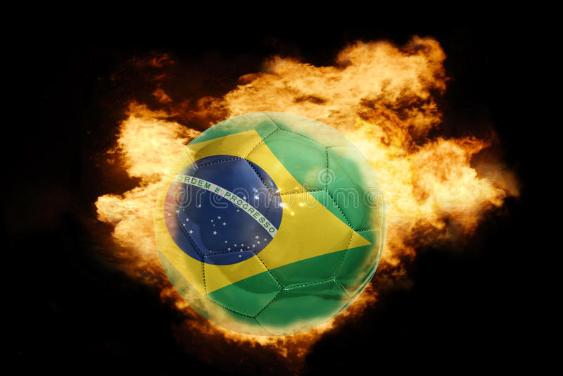 Football ball with the flag of brazil on fire royalty free stock photos