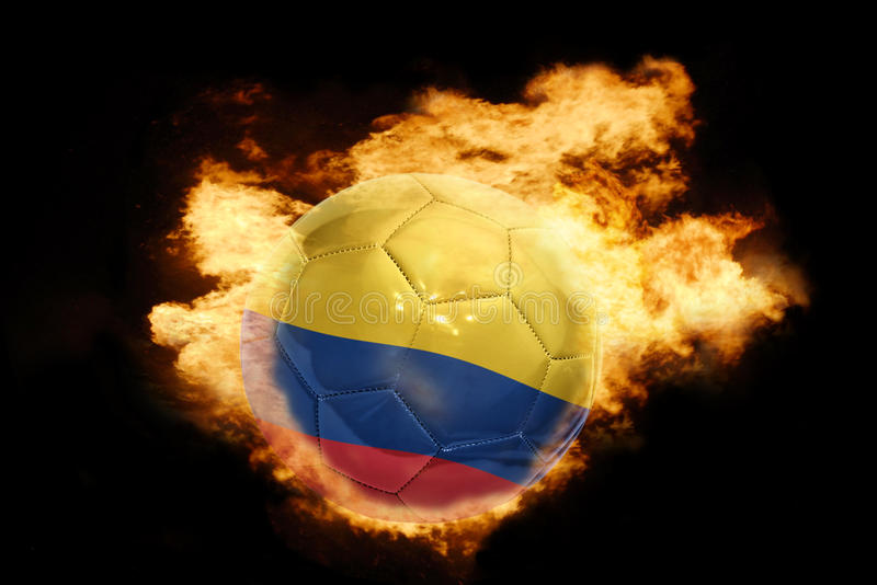 Football ball with the flag of colombia on fire royalty free stock images