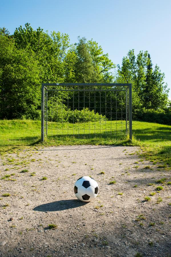 Football, ball on penalty spot, football ground for the youth. Football for kids, friends meeting on weekend fun royalty free stock photo