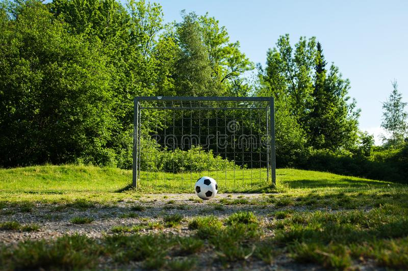 Football, ball on penalty spot, football ground for the youth. Football for kids, friends meeting on weekend fun royalty free stock photos