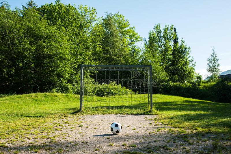 Football, ball on penalty spot, football ground for the youth. Football for kids, friends meeting on weekend fun stock photo