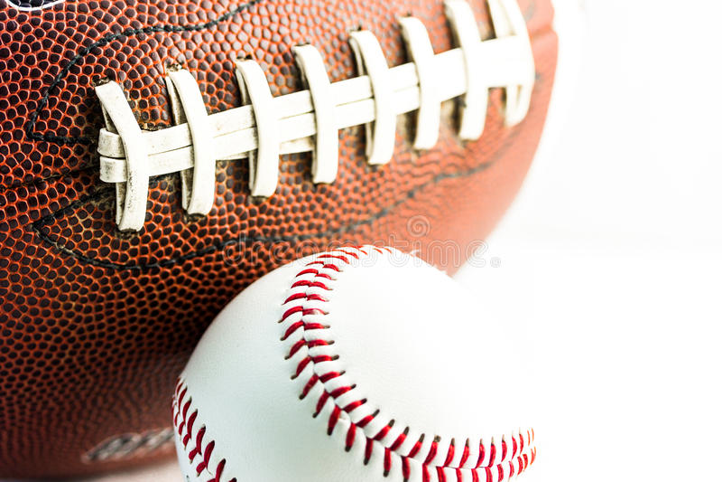 Football and baseball balls. Sport equipment stock photo