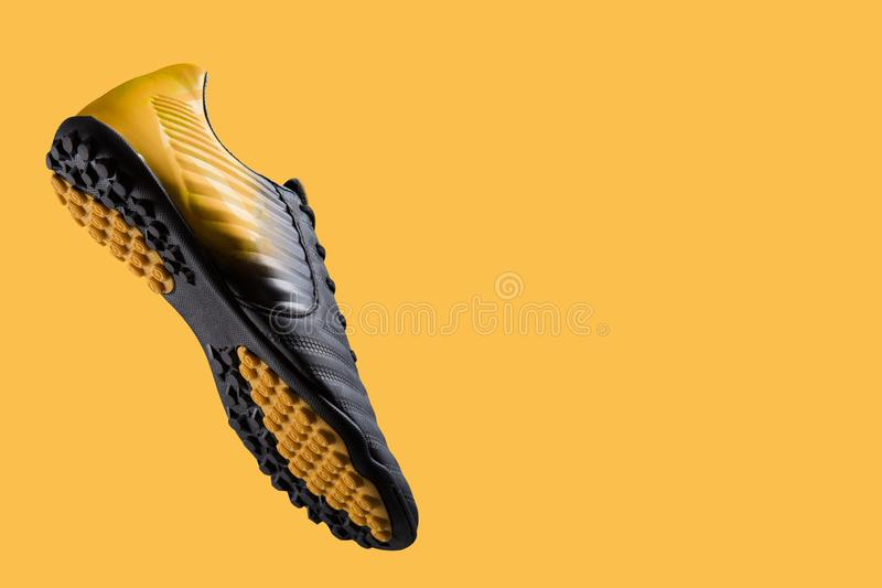 Football boot hovering in the air, as if hitting the ball, concept, sports shoes for football royalty free stock images