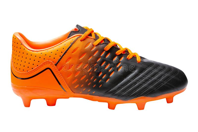 Football boots, combined color orange with black, sports shoes, on a white background royalty free stock photos