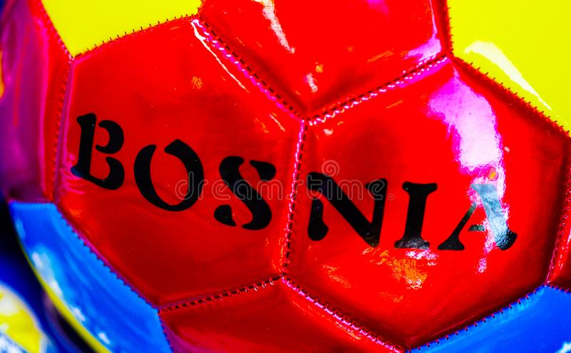 Football with Bosnia logo printed on top. Sale at the market royalty free stock photography