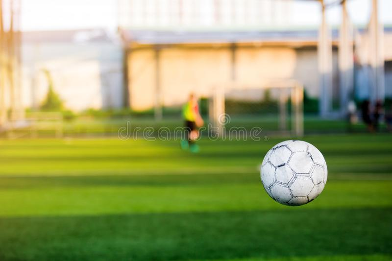 Football bounce with blurry soccer training. On artificial turf stock photo