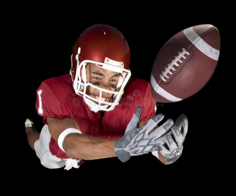 Football Catch. Football player dives for catch stock image