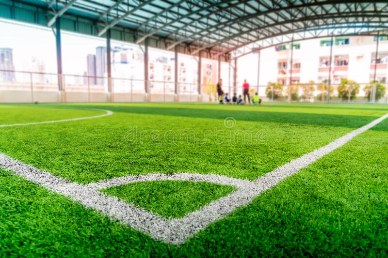 Football Corner line on green artifact grass of soccer indoor pitch stock photography
