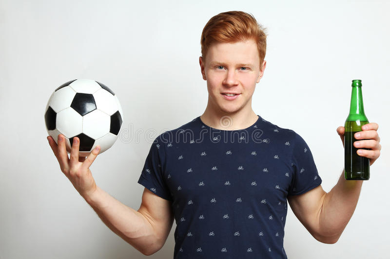 Football fan with beer royalty free stock image